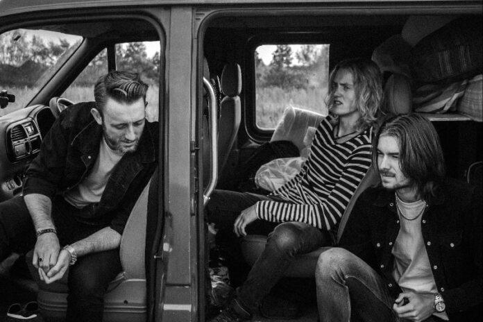 Three Men Sitting in a Van