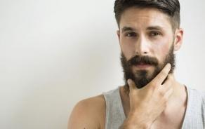 man-rubbing-beard