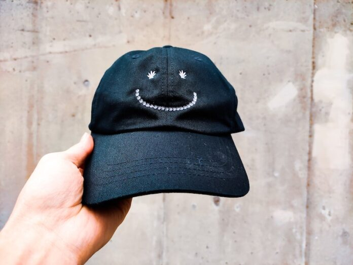 Hat with cannabis smiley face