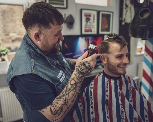 STU WALLWORK-WALSH working in barbershop
