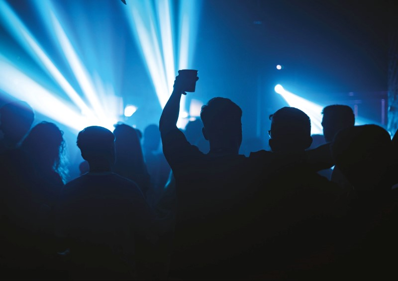 Blue lights, people drinking in club and dancing
