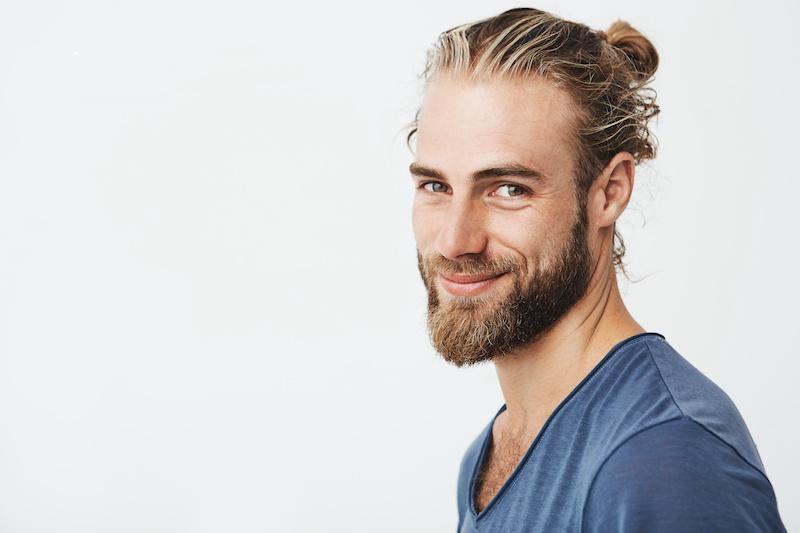 Bearded man smiling at camera