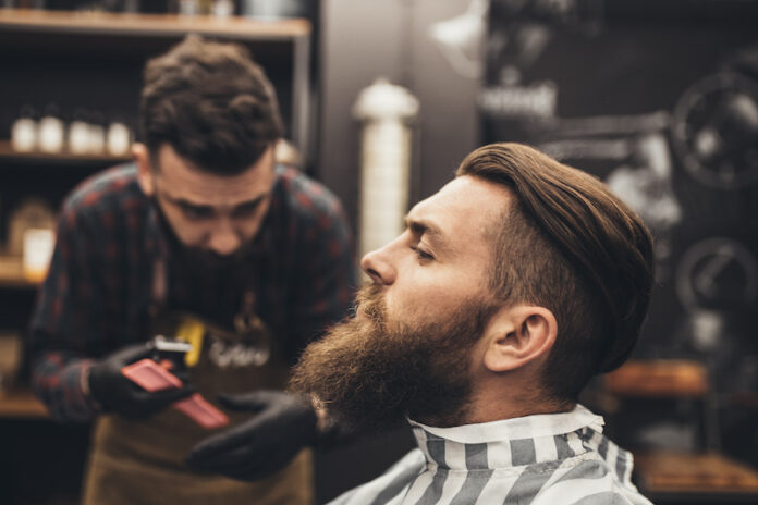 Beard getting trimmed by barber