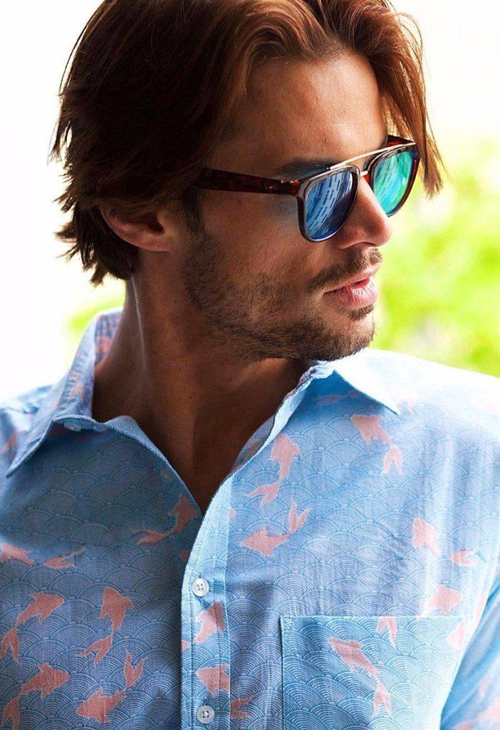 man wearing frangipani style shirt