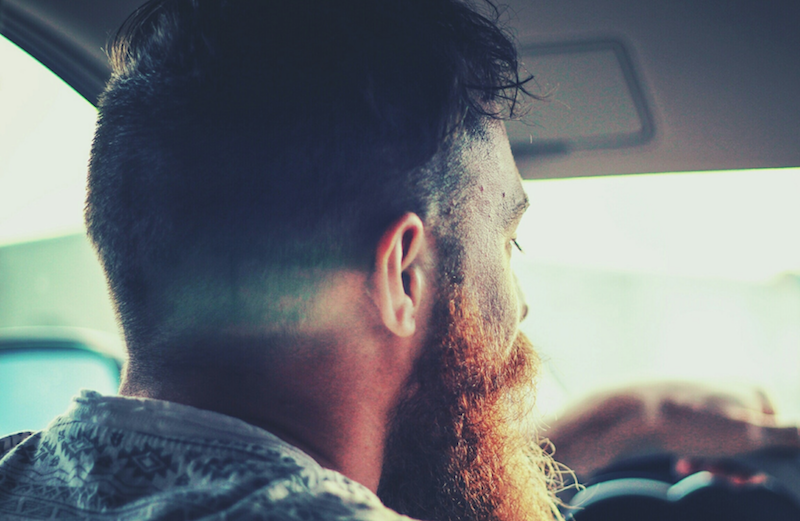 bearded man driving car