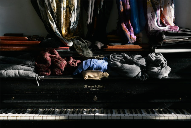 old clothes on a piano