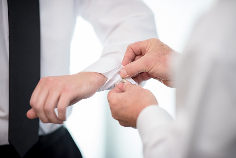 man with cufflinks being adjusted