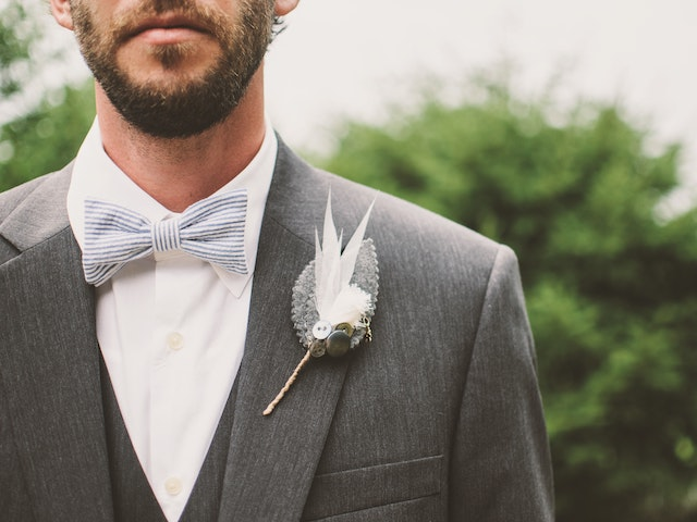 bearded man in wedding suit