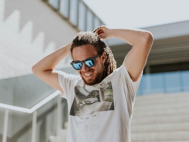 man with dreadlocks smiling