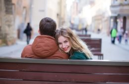 couple in love sitting on bench