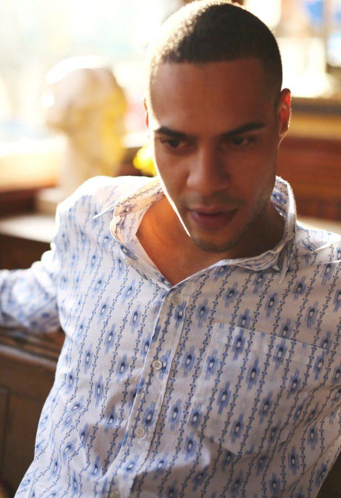man wearing frangipani style festival shirt