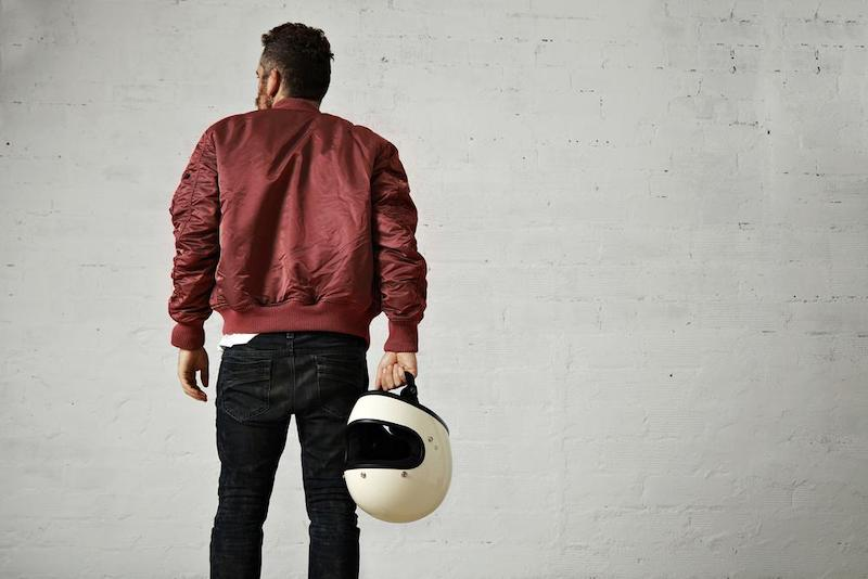 man with leather jacket and holding helmet