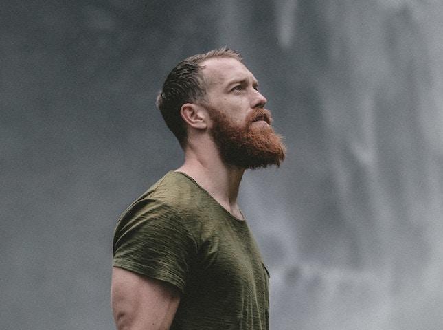 bearded man by waterfall