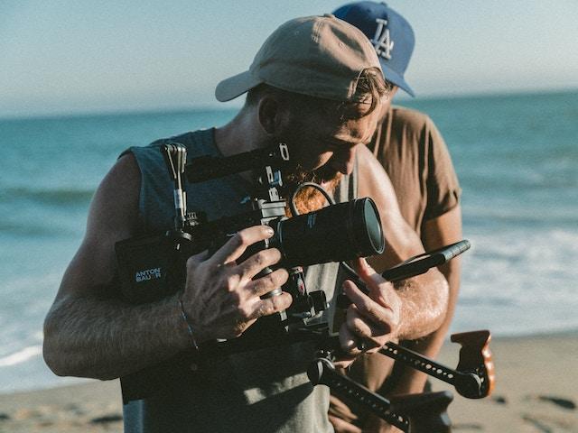 bearded man holding camera