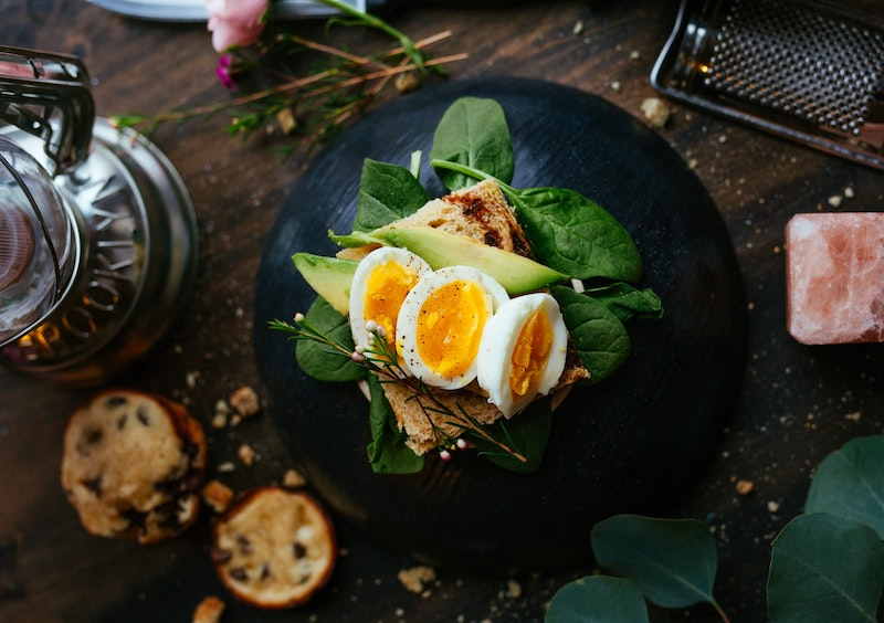 Boiled Egg on toast with avocado and spinach
