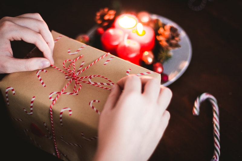 Person unwrapping present