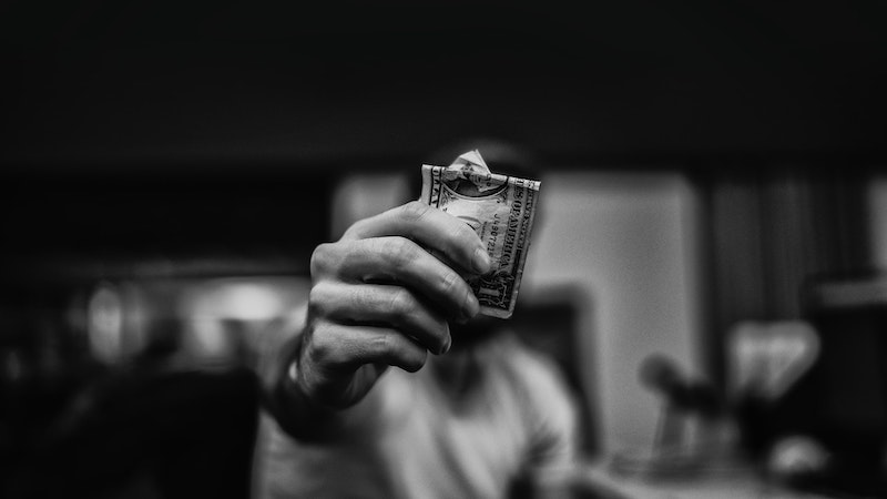 Man holding money out