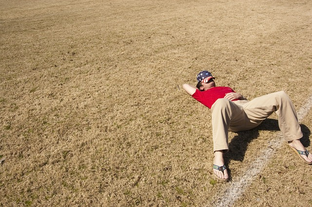 man sleeping in field