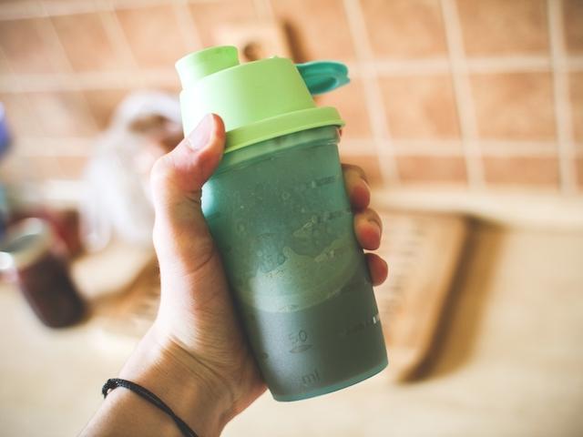 man-holding-fitness-gainerprotein-shake-picjumbo-com-1