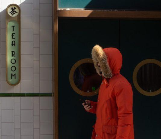 bearded man wearing orange puffer jacket
