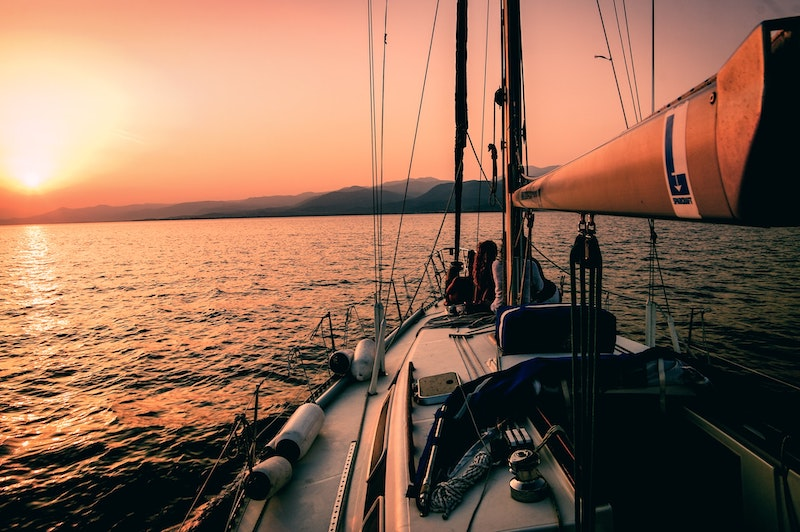 Sailing boat looking at sunset