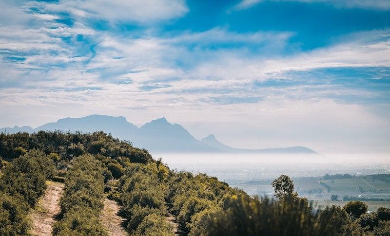 mountainous range with road leading to it