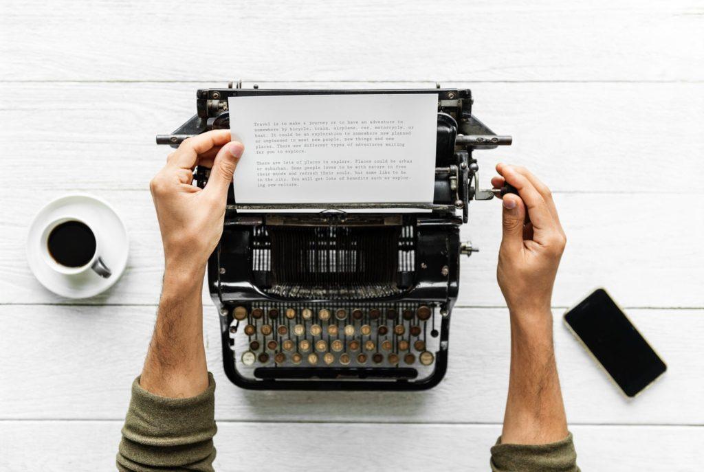 man on typewriter