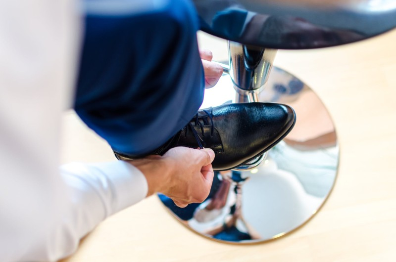 man putting on smart shoe