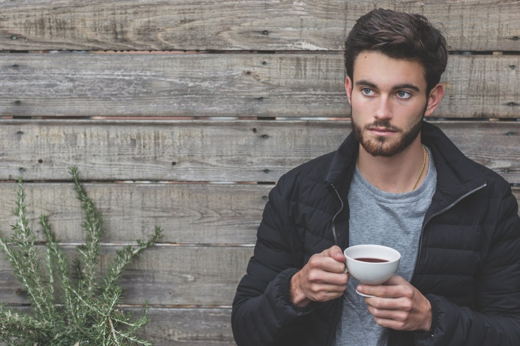 bearded man drinking coffee