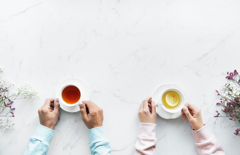 two people drinking herbal tea