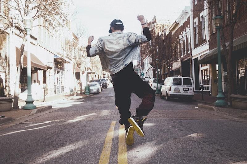 man jumping in street