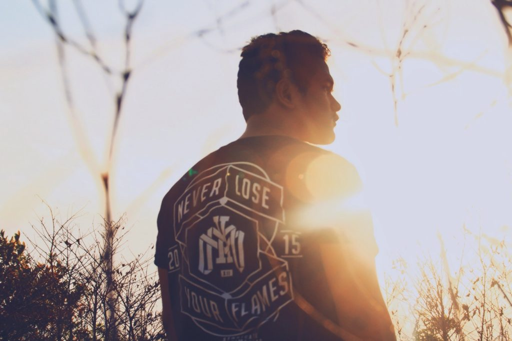 man with cool t-shirt design looking into sun