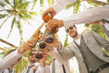 men drinking in suits