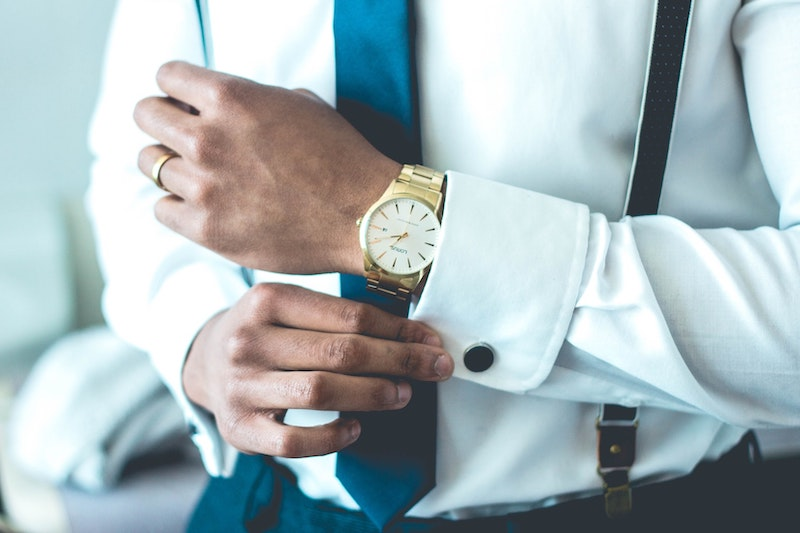 close up of man in shirt with gold watch