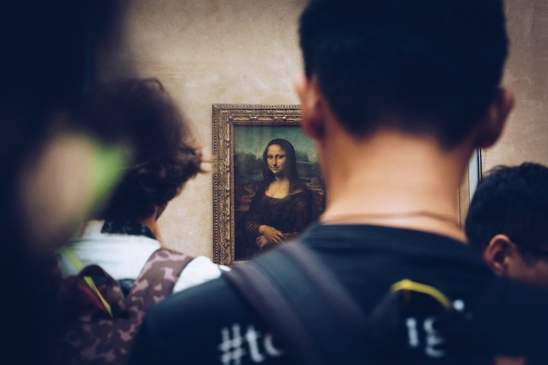 man standing in front of mona lisa