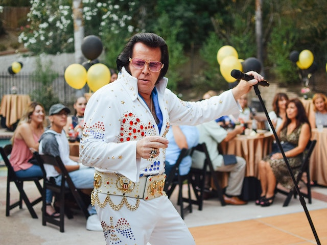 elvis impersonator at outdoor event
