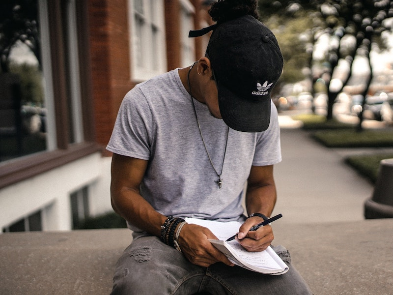 man writing white tee