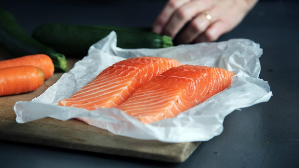 two pieces of salmon on baking paper