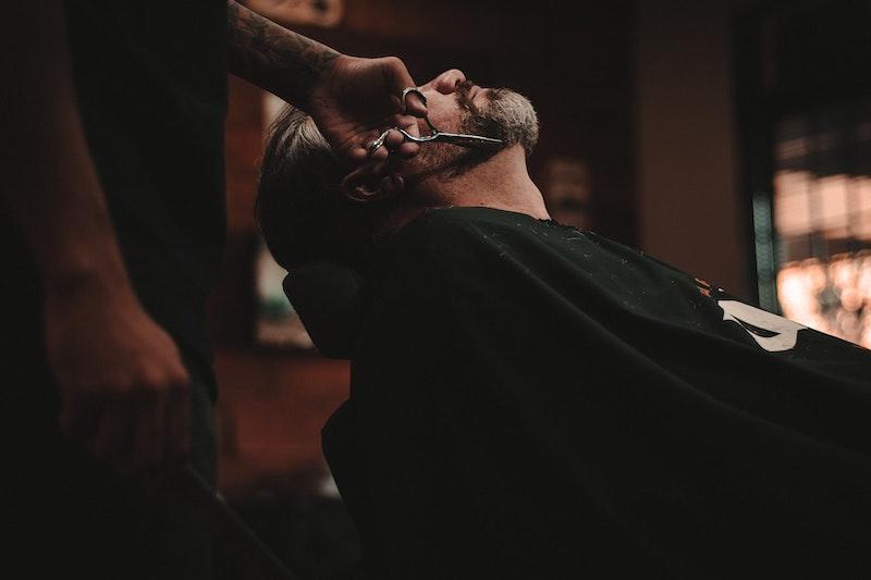 man getting beard trimmed