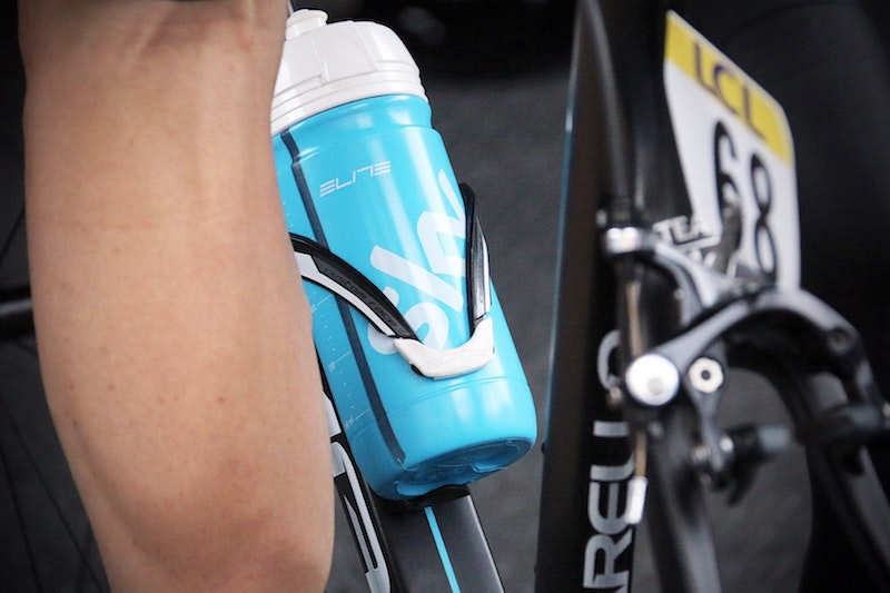 water bottle attached to a road bike