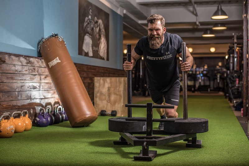 bearded man working out at gym