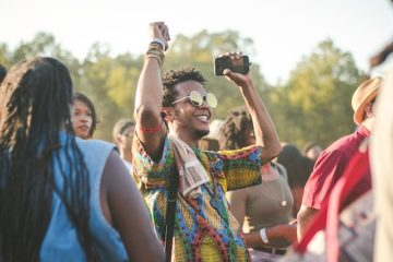 man celebrating at a festival with snazzy shirt