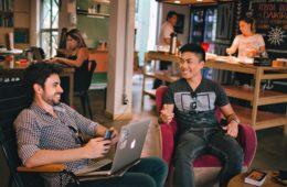 men sitting in a hostel lounge