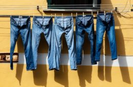 summer jeans hanging from window