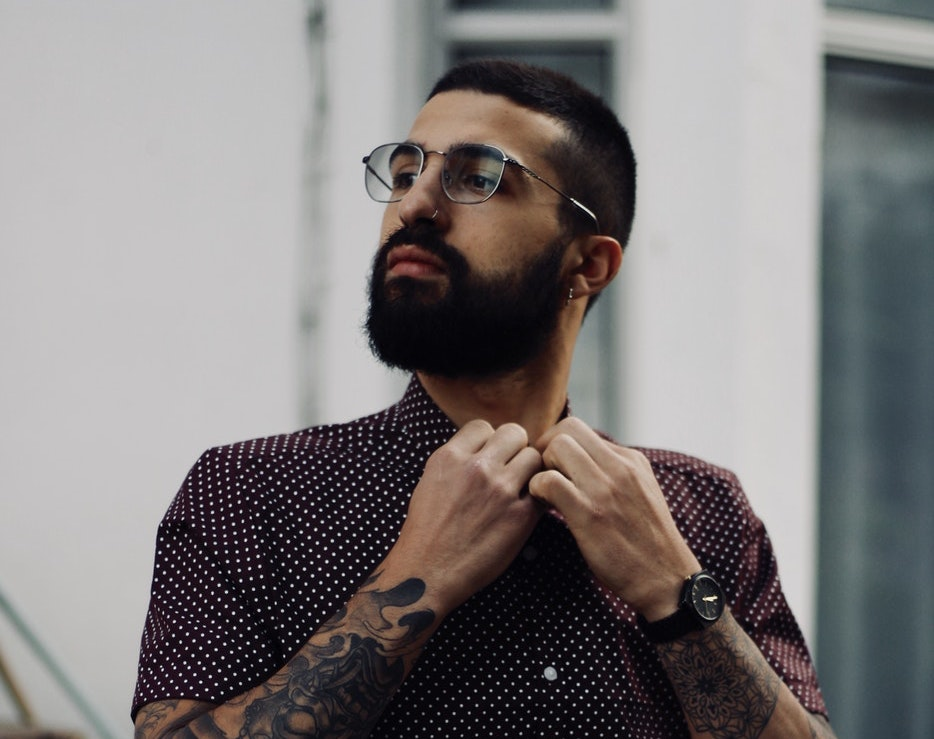 man with glasses and small beard