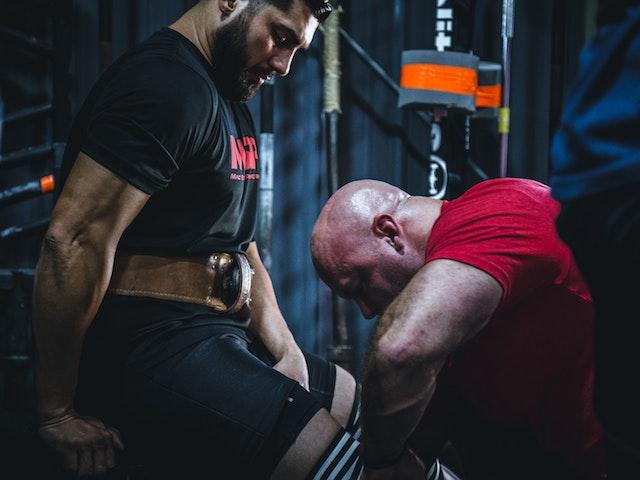 man resting at gym