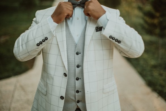 man in white suit bow tie