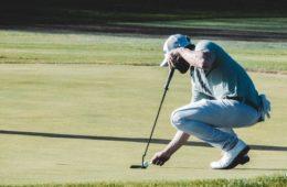 bearded golfer setting golf ball