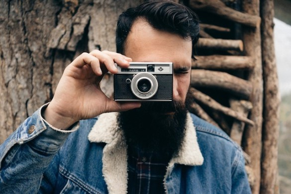 bearded man with camera