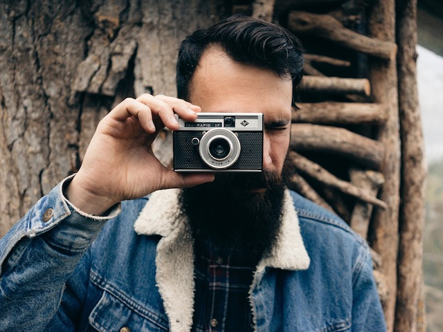 bearded man with camera
